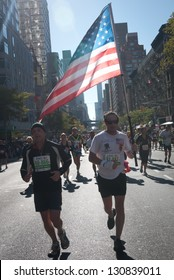 NEW YORK CITY - NOV. 6:  NYC marathon runs the American flag through New York City on Nov. 6, 2011. The NYC marathon was not held in 2012 due to Hurricane Sandy.