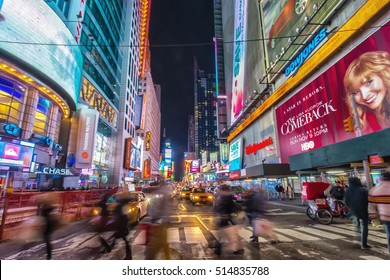NEW YORK CITY - NOV 8: A crowded Times Square at 42nd St, featured with Broadway Theaters and animated LED signs on November 8, 2014. Times Square holds the annual New Year's Eve ball drop.