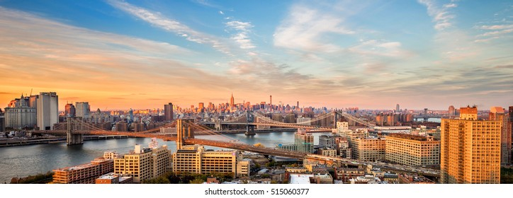 NEW YORK CITY - NOV 9: Panoramic sunset aerial view of East River, Manhattan and Brooklyn Bridge on November 9, 2014. Both bridges connect downtown Manhattan to Brooklyn.