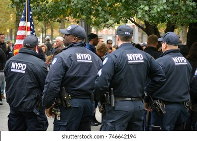 New York City - November 1, 2017: Members of the NYPD taking part in a moment of silence in Lower Manhattan to honor those killed in the terrorist truck attack in Tribeca the day before.