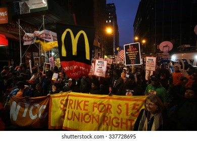 NEW YORK CITY - NOVEMBER 10 2015: Fight for Fifteen's national day of action began with a walk-out of fast food employees & rally in downtown Brooklyn where mayor de Blasio spoke.