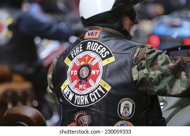 NEW YORK CITY - NOVEMBER 11 2014: the 95th annual Veteran's Day parade along Fifth Avenue is the largest Nov 11 celebration in the United States. FDNY motorcycle club members, Fire Riders