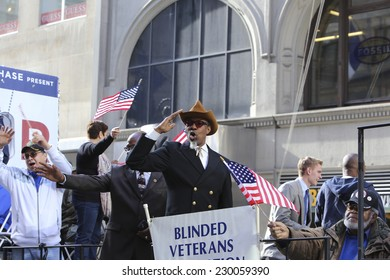 NEW YORK CITY - NOVEMBER 11 2014: the 95th annual Veteran's Day parade along Fifth Avenue is the largest Nov 11 celebration in the United States. Blind veterans association on flat