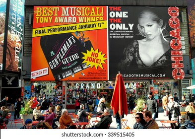 New York City - November 15, 2015:  Huge billboards advertising hit Broadway musicals A Gentleman;s Guide and Chicago in Times Square *