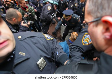 NEW YORK CITY - NOVEMBER 17 2011: Occupy Wall Street, a popular movement opposed to malfeasance on Wall Street, protested expulsion from Zuccotti Park with marches all over NYC. Swarming arrest