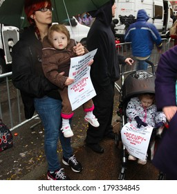 NEW YORK CITY - NOVEMBER 17 2011: Occupy Wall Street, a popular movement opposed to malfeasance on Wall Street, protested expulsion from Zuccotti Park with marches all over NYC. Toddlers with signs