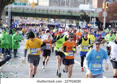 NEW YORK CITY - NOVEMBER 2 2014: the 43rd annual NYC Marathon saw more than 50,000 entrants race through all five boroughs. Runners fill Fourth Avenue, Brooklyn at mile four mark
