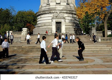 New York City - November 2, 2005: Jewish students from a local Yeshiva school playing soccer in the Soldiers and Sailors Monument plaza in Riverside Park