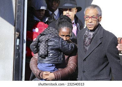 NEW YORK CITY - NOVEMBER 22 2014: Rev Al Sharpton held a rally at National Action Network headquarters to protest the death of Akai Gurley. Al Sharpton escorts Kimberly Ballinger & Akaila Gurley