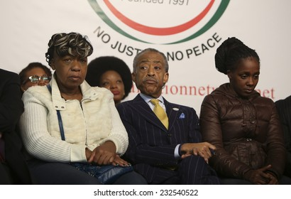 NEW YORK CITY - NOVEMBER 22 2014: Rev Al Sharpton held a rally at National Action Network headquarters to protest the death of Akai Gurley. Gwen Carr, Al Sharpton & Kimberly Michelle Williams on stage