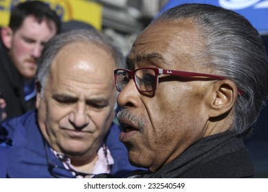 NEW YORK CITY - NOVEMBER 22 2014: Rev Al Sharpton held a rally at National Action Network headquarters to protest the shooting death of Akai Gurley by NYPD officers. Rev Sharpton speaks to the media