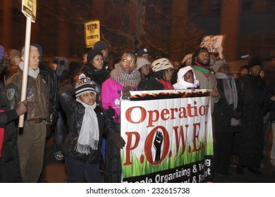 NEW YORK CITY - NOVEMBER 22 2014: nearly two hundred activists gathered at the Louis Pink Houses in Brooklyn before marching to Police Services #2 station demanding justice in the death of Akai Gurley