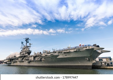 """NEW YORK CITY - NOVEMBER 23, 2013: navy ship USS Intrepid,  also known as The Fighting """"I"""". Decommissioned in 1974, in 1982 Intrepid became the foundation of the Intrepid Sea, Air & Space Museum."""