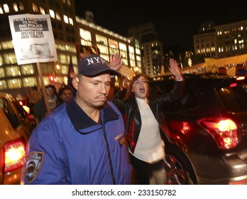 NEW YORK CITY - NOVEMBER 25 2014: several hundred gathered at Union Square to await announcement of the Ferguson grand jury's verdict in the death of Michael Brown followed by a march to Times Square