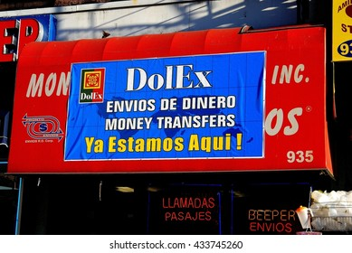 New York City - November 25, 2006:  Bilingual sign in English and Spanish on a money transfer store on the Upper West Side
