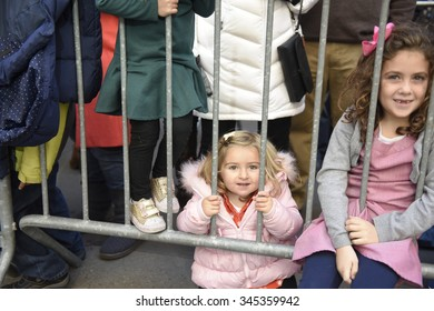 NEW YORK CITY - NOVEMBER 26 2015: The 89th annual Macy's Thanksgiving Day parade attracted hundreds of thousands of spectators in spite of threats of possible terrorist action. Little spectators