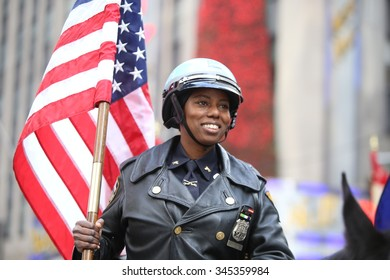 NEW YORK CITY - NOVEMBER 26 2015: The 89th annual Macy's Thanksgiving Day parade attracted hundreds of thousands of spectators in spite of threats of possible terrorist action. Mounted NYPD with flag