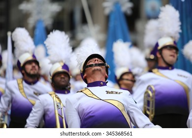 NEW YORK CITY - NOVEMBER 26 2015: The 89th Macy's Thanksgiving Day parade attracted hundreds of thousands of spectators in spite of threats of possible terrorist action. Marching band with moves