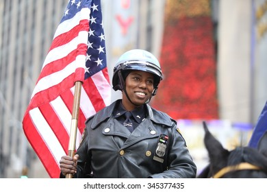 NEW YORK CITY - NOVEMBER 26 2015: The 89th Macy's Thanksgiving Day parade attracted hundreds of thousands of spectators in spite of threats of possible terrorist action. Mounted NYPD officer