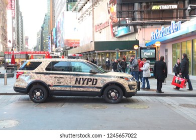 NEW YORK CITY - NOVEMBER 28, 2018 : NYPD Veterans Day 2018 car at Times Square. The New York City Police Department, established in 1845, is the largest municipal police force in the United States.