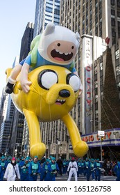 NEW YORK CITY - NOVEMBER 28 2013: Thanksgiving in New York City was celebrated by the 87th annual Macy's Thanksgiving Day Parade. Finn & Jake from Adventure Time November 28 2013 in New York City