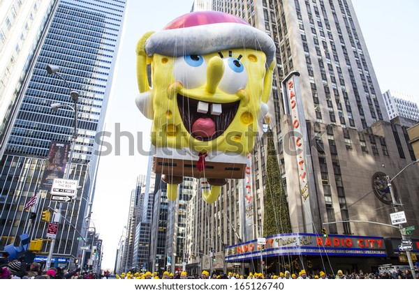 NEW YORK CITY - NOVEMBER 28 2013: Thanksgiving in New York City was celebrated by the 87th annual Macy's Thanksgiving Day Parade. Spongebob Squarepants by Radio City November 28 2013 in New York City