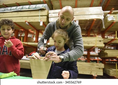 NEW YORK CITY - NOVEMBER 29 2015: Friendship Circle of Brooklyn held its annual craft fare for special needs students at Home Depot  this year building menorahs for Hanukkah.