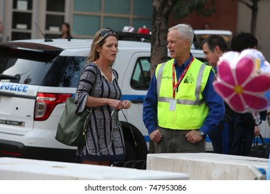 NEW YORK CITY - NOVEMBER 3 2017: Impromptu memorials were placed at the corner of Chambers and West Streets to honor victims of the attack.  Counselors with Billy Graham Crusade chat with passersby