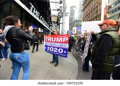 NEW YORK CITY - NOVEMBER 4 2017: Several hundred activists rallied in Times Square to mark the coming anniversary of the 2016 election upset that put Trump in office