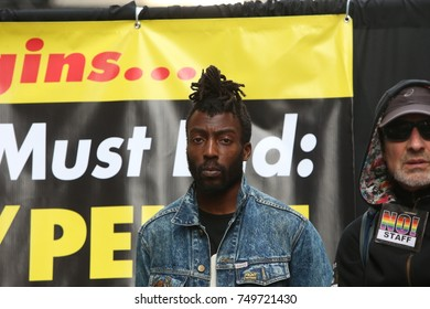 NEW YORK CITY - NOVEMBER 4 2017: Several hundred activists rallied in Times Square to mark the coming anniversary of the 2016 election upset that put Trump in office. RevCom organizer Jamal Mims