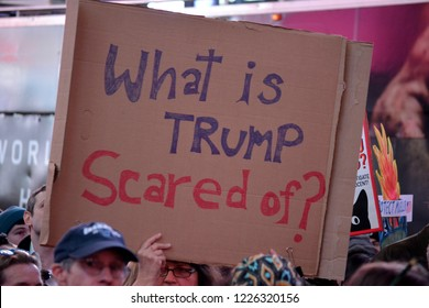 New York City - November 8, 2018: People holding signs at a rally in Time's Square supporting Robert Mueller and the Russia investigation after the firing of Attorney General Jeff Sessions.