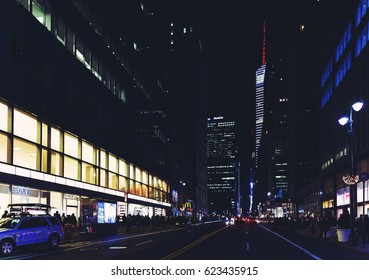 NEW YORK CITY, NY - 03 December, 2016: Madison Avenue (Manhattan, New York) by night, featuring the Bank of America Tower and Met Life Building
