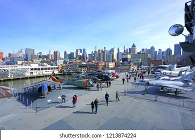 NEW YORK CITY, NY -27 JAN 2018- View of military airplanes on the deck of the USS Intrepid Sea, Air & Space Museum, a historic aircraft carrier with the Manhattan New York skyline in the background.