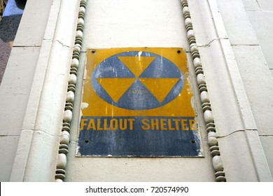 NEW YORK CITY, NY -27 AUG 2017- Yellow and black warning sign for a nuclear fallout shelter dating back to the Cold War in Manhattan, New York City.