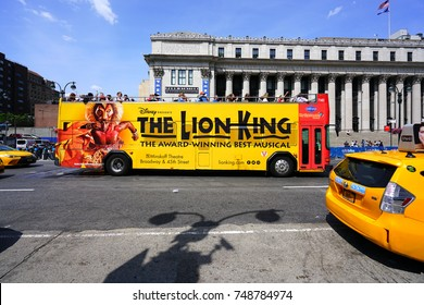 NEW YORK CITY, NY -27 AUG 2017- View of a bus advertising the award-winning Broadway musical The Lion King on the street in New York City.