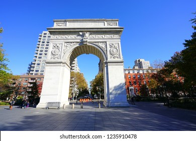 NEW YORK CITY, NY -9 NOV 2018- Autumn view of the Washington Square Arch with foliage, located in the Greenwich Village neighborhood of Lower Manhattan near the campus of New York University (NYU).