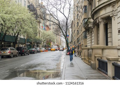 NEW YORK CITY, NY - APRIL 26,2018 : Street life of Upper East Side in Manhattan on a Rainy Day in New York City,NY on April 26,2018.