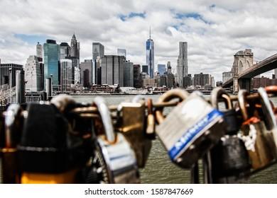 NEW YORK CITY, NY - APRIL 23, 2014: New York city lover Manhattan architecture view from Brooklyn Bridge  Park