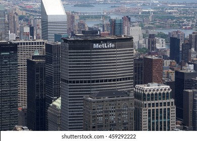 New York City, NY - July 12 2016: Aerial view top of Metlife building next to grand central terminal in the Manhattan skyline surrounded by building rooftops