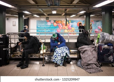 New York City, NY - March 22, 2017: Unidentified homeless people sleeping at the subway station in New York City, NY