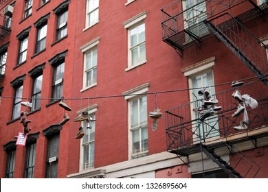 New York City, NY - March 09 2017: Shoes hangin from an electric wire in Manhattan, New York
