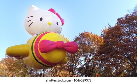 NEW YORK CITY, NY - NOVEMBER 23: Hello Kitty Balloon flying through streets during Macy's Thanksgiving Day Parade on November 23, 2018, in New York City, New York.
