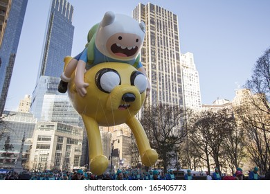 NEW YORK CITY, NY - NOVEMBER 28: Jake and Finn, from Adventure time, balloon in city for the Macy's 87th Annual Thanksgiving Day Parade on November 28, 2013 in New York City, New York.