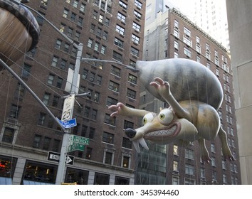 NEW YORK CITY, NY - NOVEMBER 26 - Ice Age Squirrel float between buildings on 6th avenue during the Macy's 89th Annual Thanksgiving day parade on November 26, 2015 in New York City, New York.