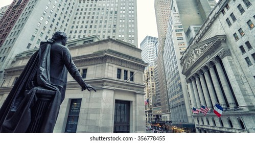 NEW YORK CITY, NY - November 18: The side entrance of New York Stock Exchange and a street sign of Wall Street shown on November 18, 2015 in New York City. The Exchange building was built in 1903.