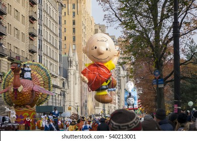 NEW YORK CITY, NY - NOVEMBER 24 : Charlie Brown Balloon holding kite flying down 8th Avenue during Macy's 90th Annual Thanksgiving Day Parade on November 24, 2016 in New York City, New York.
