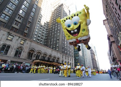 NEW YORK CITY, NY - NOVEMBER 24: Nickelodeon Sponebob Squarepants towers over people below in Macy's 85th Annual Thanksgiving Day Parade on November 24, 2011 in New York City, New York.