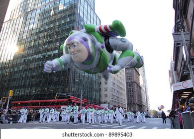 NEW YORK CITY, NY - NOVEMBER 24: Buzz Lightyear balloon flying through air with jetpack in the Macy's 85th Annual Thanksgiving Day Parade on November 24, 2011 in New York City, New York.