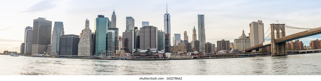 NEW YORK CITY, NY - OCTOBER 9: Panorama of Lower Manhattan with Brooklyn Bridge on October 9th, 2013 in New York City, USA. This area of Manhattan is the center of business in the City of New York.