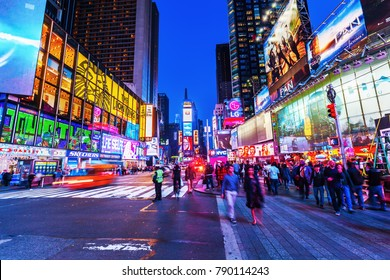 New York City, NY - October 09, 2015: Times Square at night with unidentified people. It is one of the worlds busiest pedestrian intersections and a major center of worlds entertainment industry